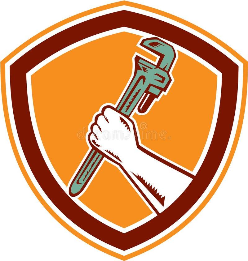 Mano que sostiene el grabar en madera del escudo de la llave ajustable libre illustration