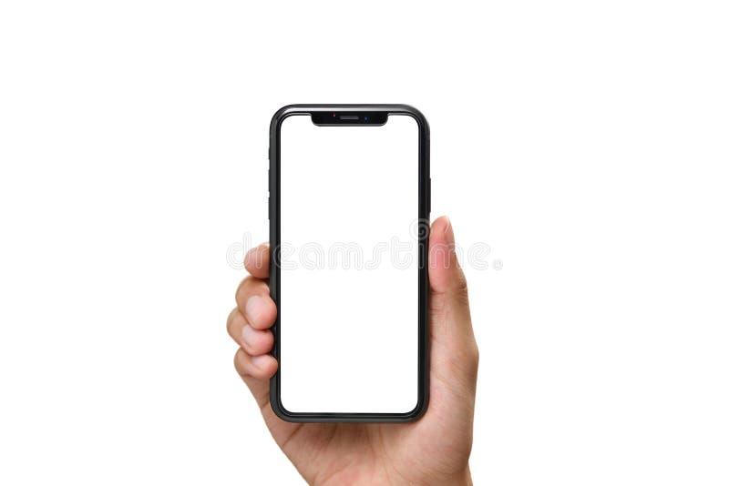 Mano que sostiene el smartphone negro con la pantalla en blanco fotos de archivo