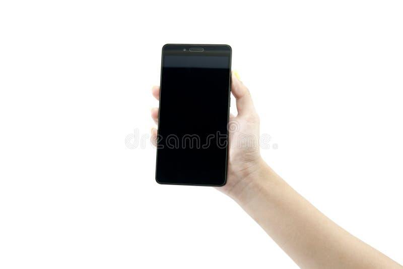 Mano que sostiene el teléfono elegante foto de archivo libre de regalías