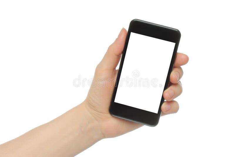 Mano que sostiene el teléfono elegante imagenes de archivo
