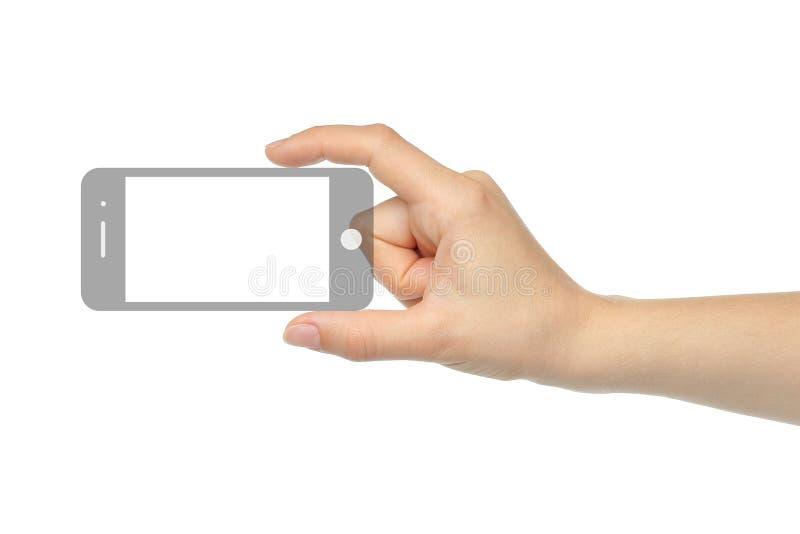 Mano que sostiene el teléfono elegante imagen de archivo libre de regalías