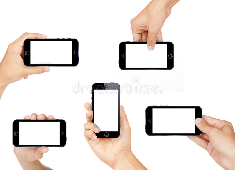 Mano que sostiene el teléfono elegante móvil imagen de archivo libre de regalías