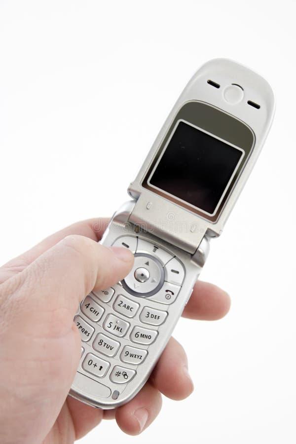 Mano que sostiene el teléfono móvil con el camino de recortes foto de archivo libre de regalías