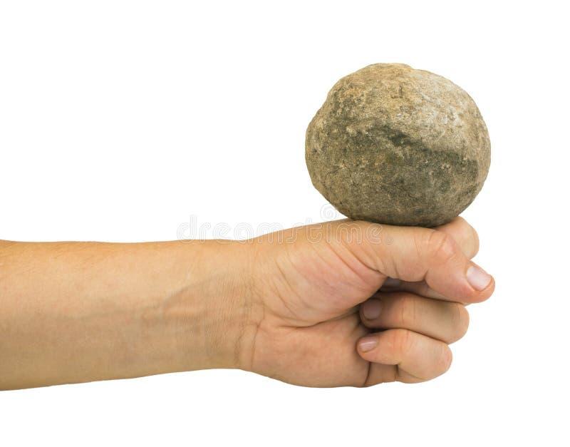 Mano que sostiene la bola de piedra fotografía de archivo