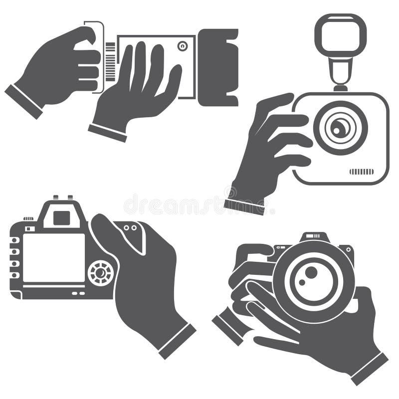 Mano que sostiene la cámara ilustración del vector