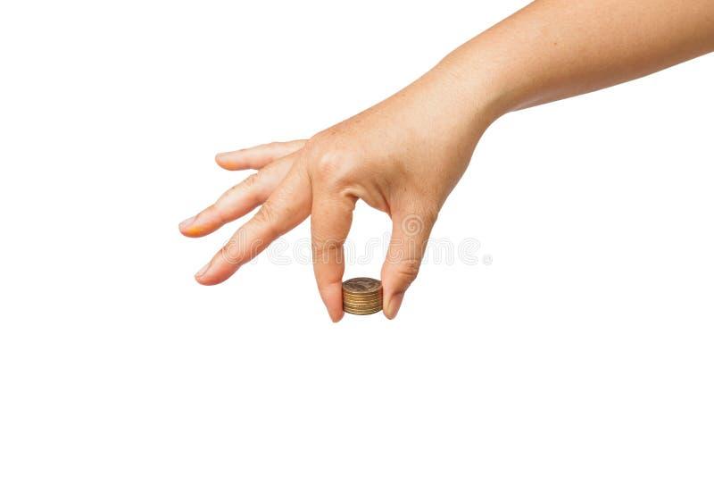 Mano que sostiene la pila de la moneda imagen de archivo