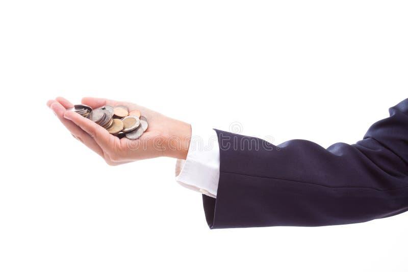 mano que sostiene monedas imagen de archivo