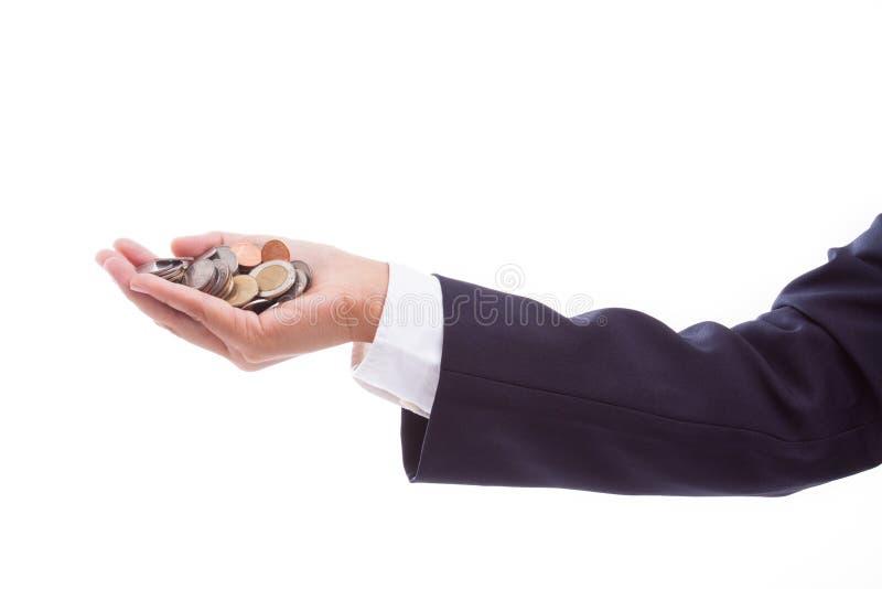 Mano que sostiene monedas imagen de archivo libre de regalías