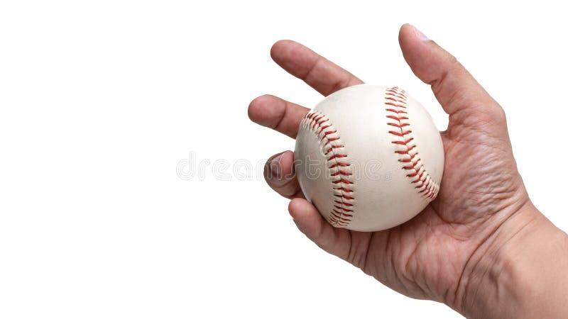 Mano que sostiene una bola del béisbol fotos de archivo libres de regalías