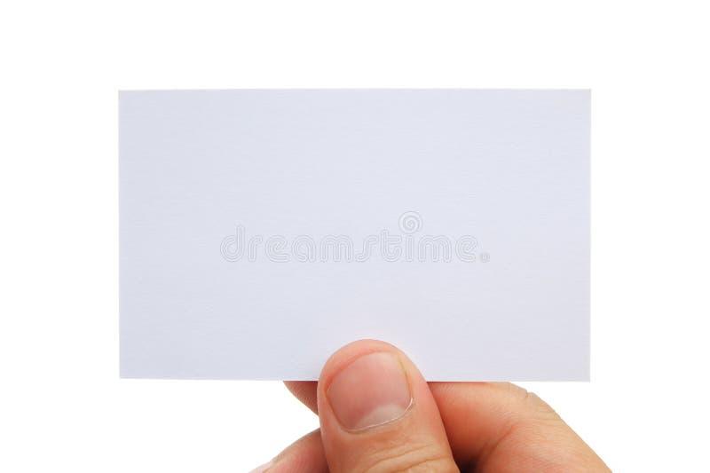 Mano que sostiene una tarjeta de visita en blanco fotografía de archivo libre de regalías