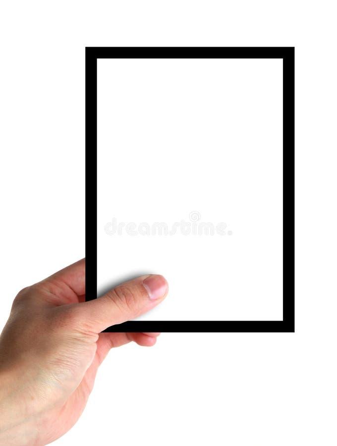 Mano que sostiene una tarjeta en blanco fotos de archivo