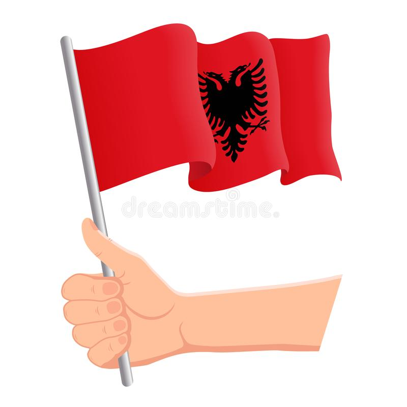 Mano que sostiene y que agita la bandera nacional de Albania r Ilustraci?n del vector libre illustration