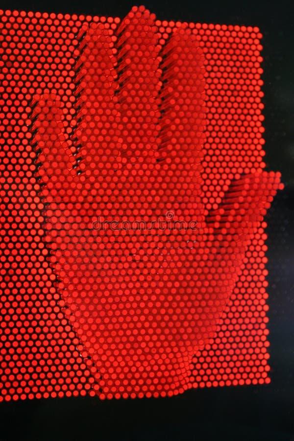 Mano roja fotografía de archivo
