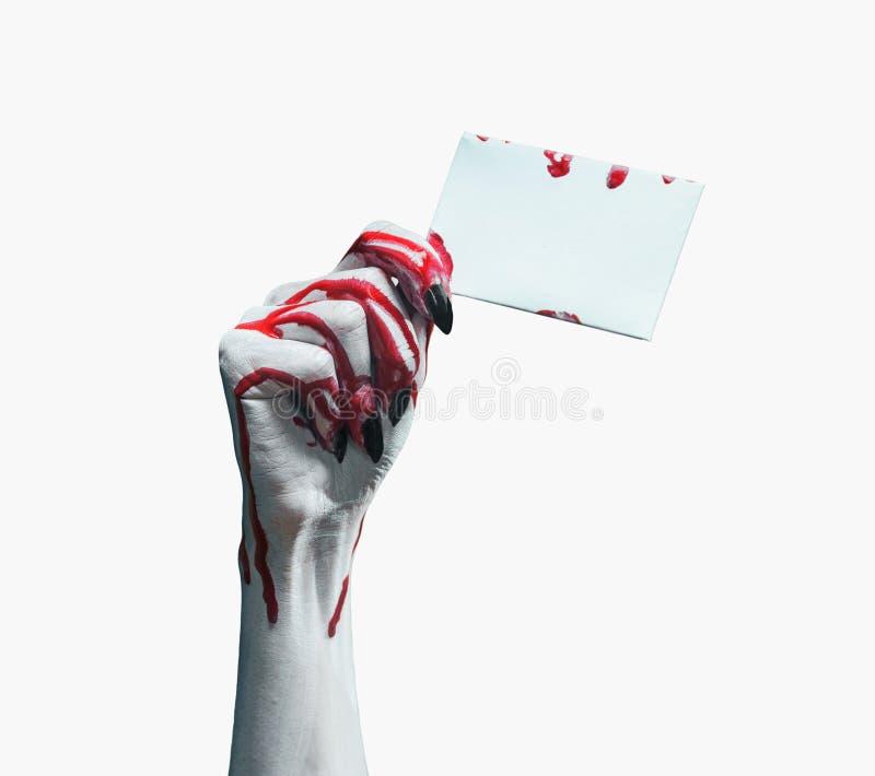 Mano sangrienta del vampiro con la tarjeta vacía imágenes de archivo libres de regalías