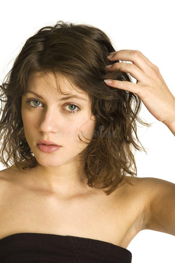 Mano in suoi capelli fotografia stock libera da diritti