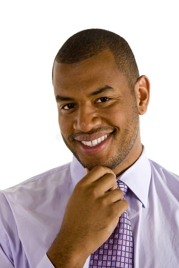 Mano vestida sostenida del hombre negro en la barbilla fotografía de archivo libre de regalías
