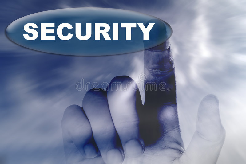 Mano y botón con la palabra de la seguridad foto de archivo