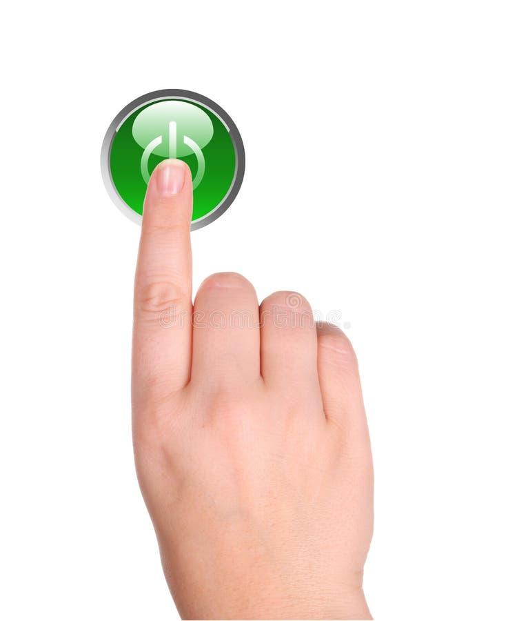 Mano y botón verde fotos de archivo libres de regalías