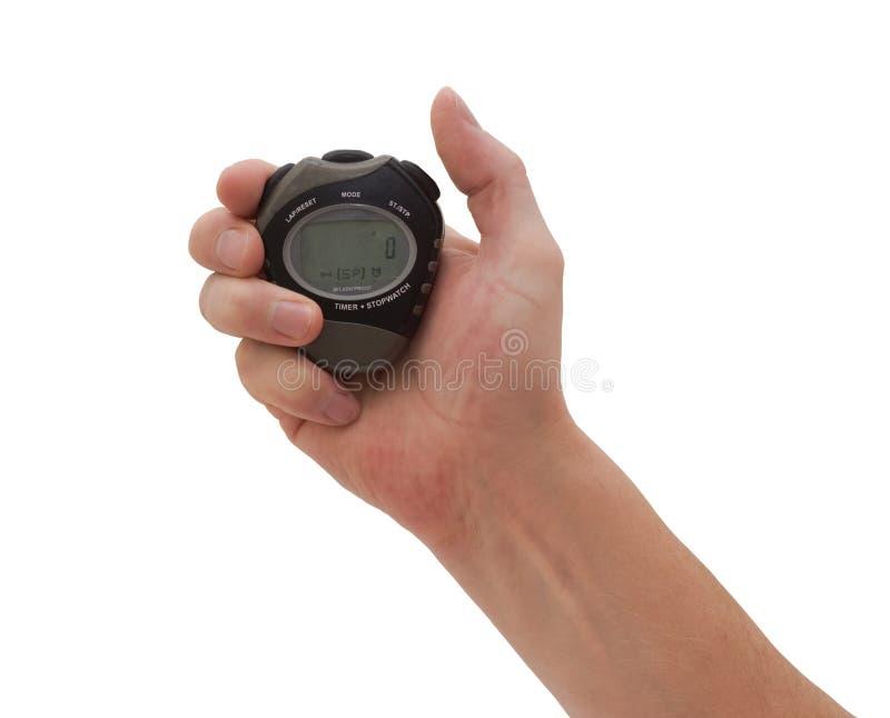 Mano y cronómetro imagen de archivo