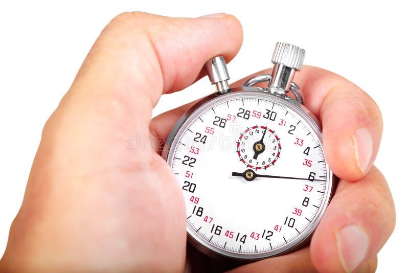 Mano y cronómetro imagen de archivo libre de regalías