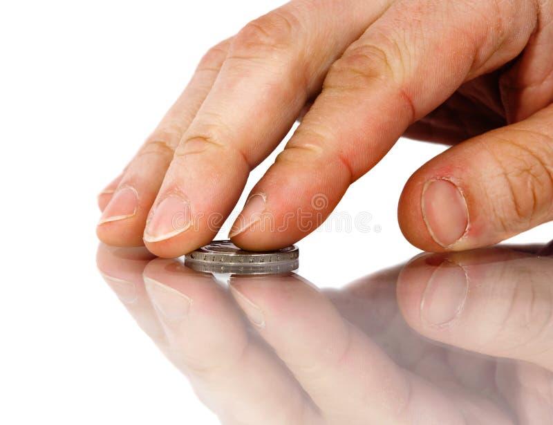 Mano y moneda fotografía de archivo