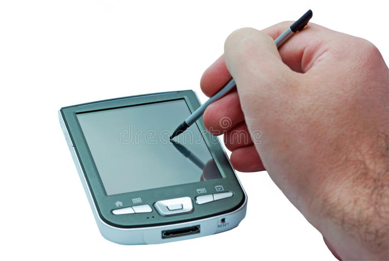 Mano y teléfono de PDA fotografía de archivo libre de regalías
