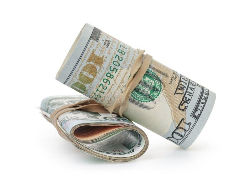 Manojo de dólares y de rublos en blanco imagen de archivo