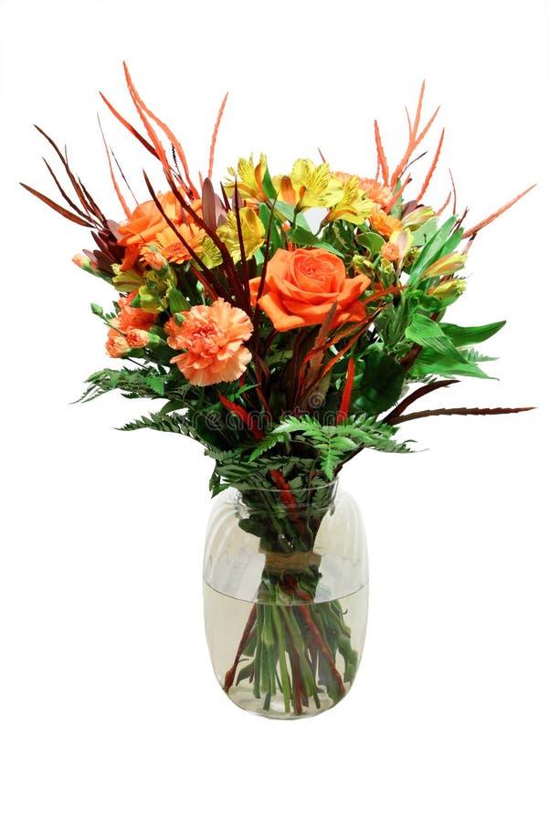 Manojo de flores en florero imágenes de archivo libres de regalías