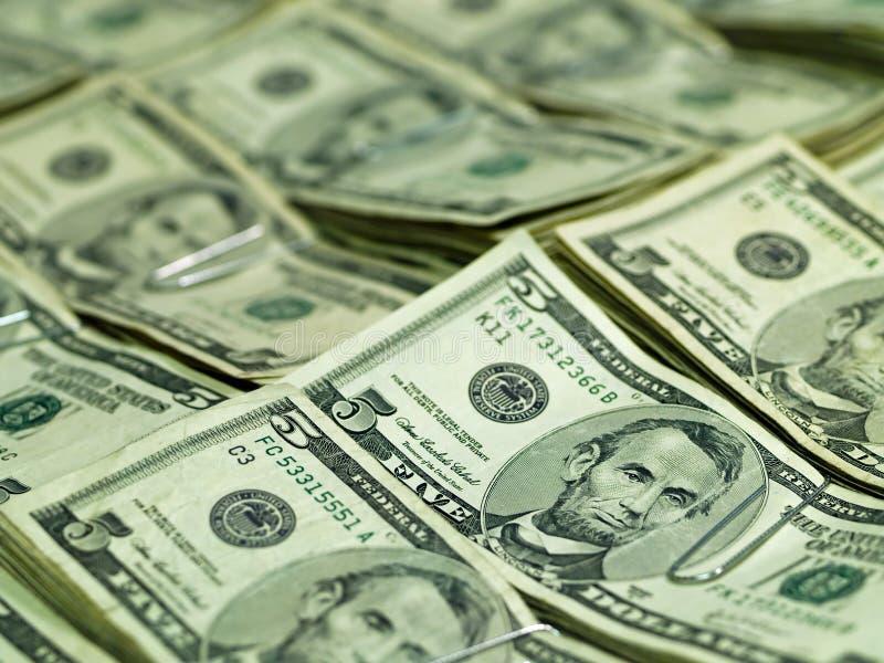 Manojos de los E.E.U.U. Cinco cuentas de dólar fotos de archivo libres de regalías