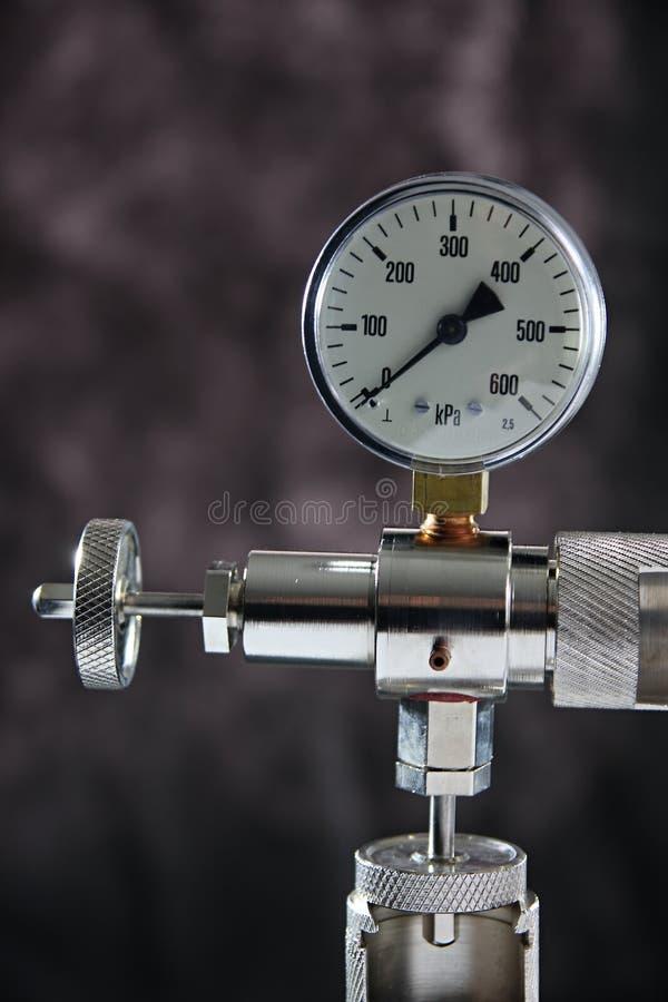 Manometer. Macro of a manometer isolated on grey background stock image