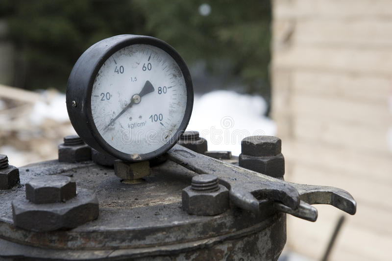 Manometer. Composition with old manometer and tools stock photos
