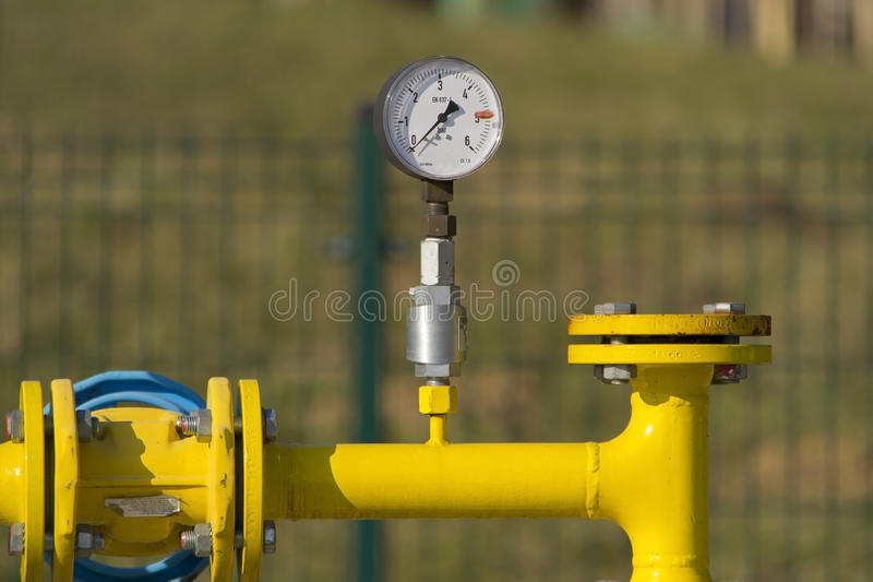 Manometer on gas pipe. Manometer on yellow natural gas pipe royalty free stock photo