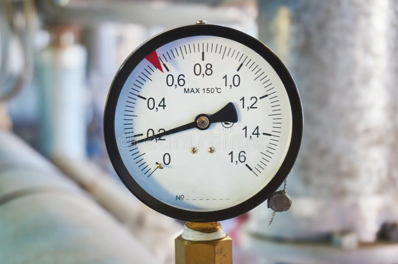 Manometer on the hot water pipeline in the boiler room. Manometer on the hot water pipeline royalty free stock images