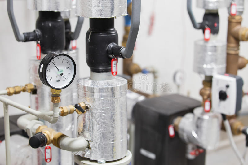 Manometer and pipelines of heating system royalty free stock image