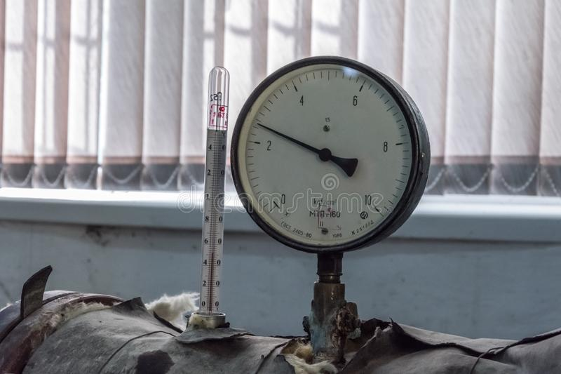 Manometer of pumping equipment of water supply stock photography
