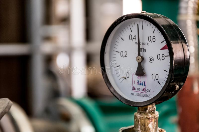 Manometer of pumping equipment of water supply stock photo