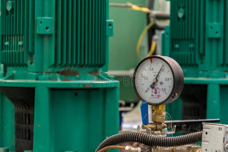 Manometer of pumping equipment of water supply stock images