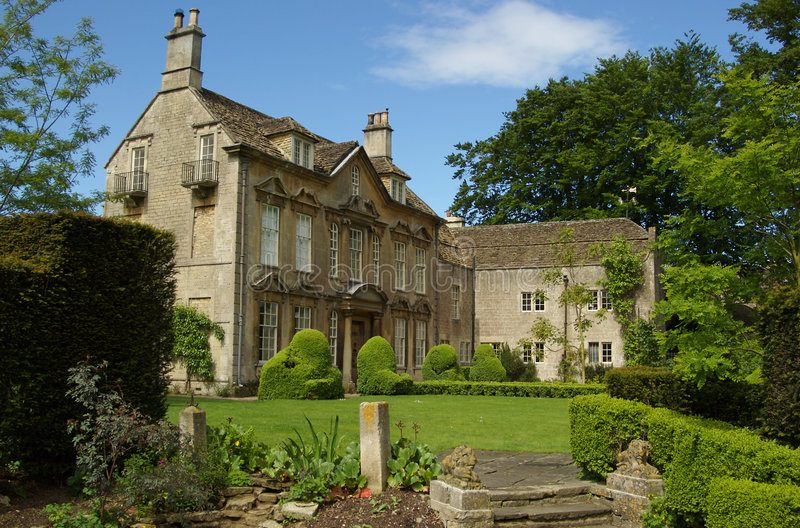 Manor House. An English manor house and its beautiful garden stock image