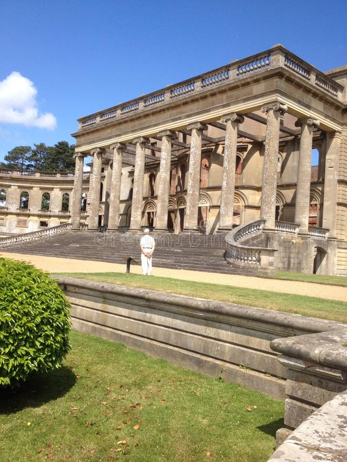 Manor House. Grand Manor House now ruins with formal gardens and grand steps to enter set against summers day with blue skies royalty free stock photos