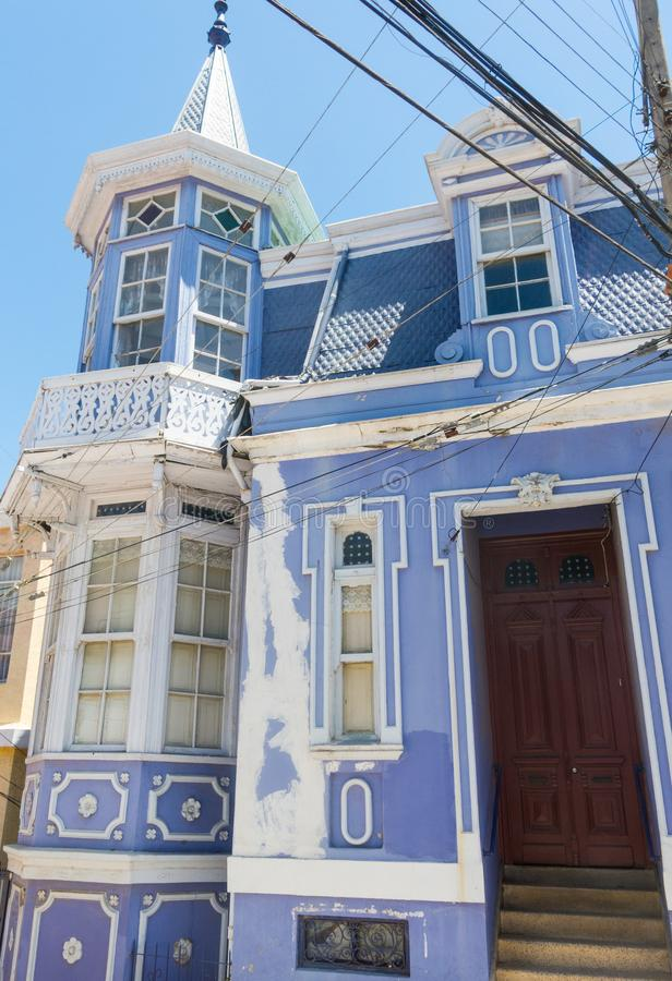 Manor house on a hill in Valparaiso, with the paint worn by the wind and salt, and the typical electric cables. Chile royalty free stock image
