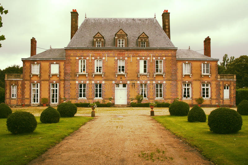 Manor house in Normandie, Rouen , France. Charming manor house in Normandie surrounded by a garden royalty free stock photos