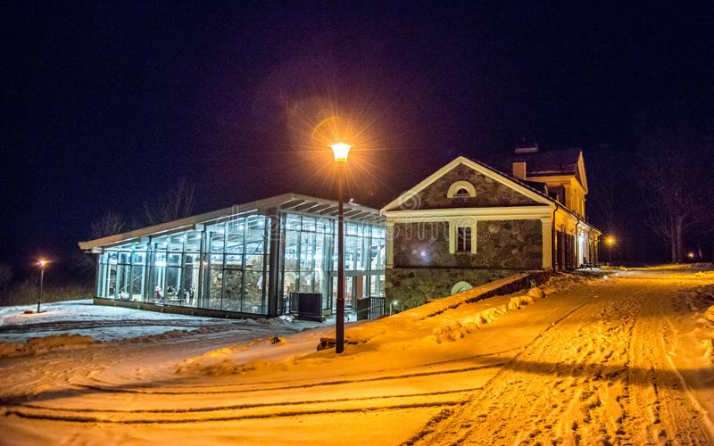 Manor house Paliesiaus Dvaras in Lithuania, night time. Manor house Paliesiaus Dvaras near Ignalina in Lithuania, winter time at night stock image
