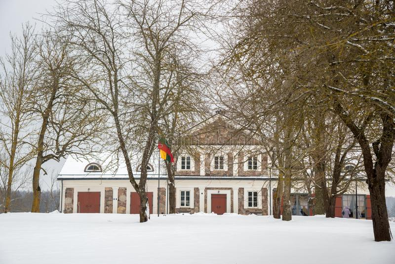 Manor house Paliesiaus Dvaras in Lithuania. Manor house Paliesiaus Dvaras near Ignalina in Lithuania, winter time royalty free stock images