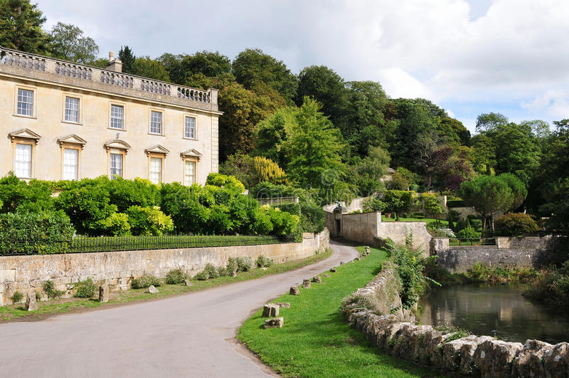 Manor House by a River. View of an English Manor House by a River and Country Road stock image