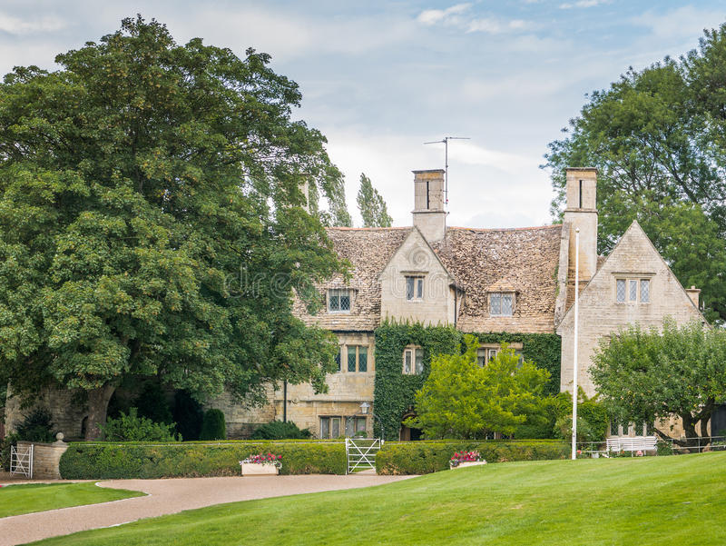 Manor house. The manor house at Weldon, Northamptonshire, England, built of limestone in the sixteenth century and noe a listed grade II* building stock photo