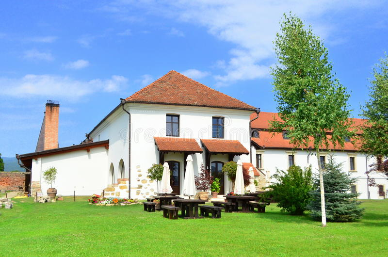 Manor, lawn and terrace - Vacation concept. Image of a holiday house with big yard an a large terrace in Alba Iulia, Romania royalty free stock photos