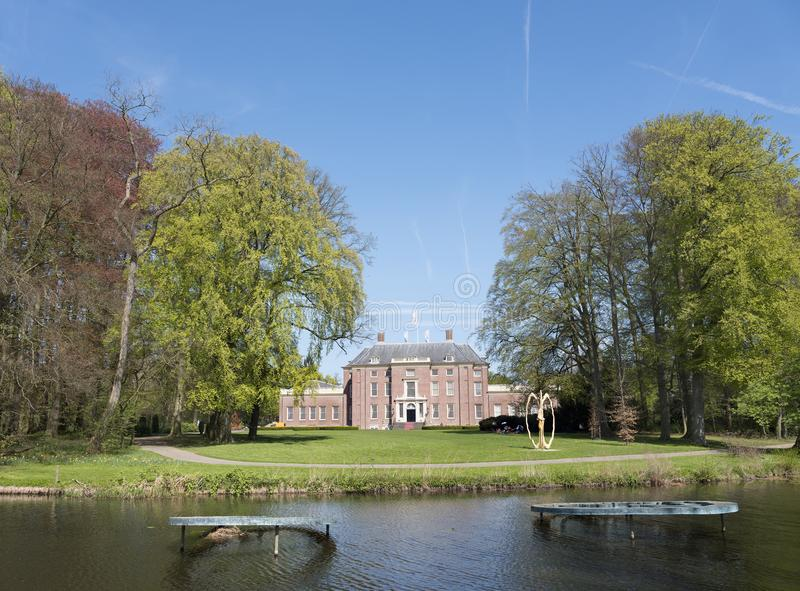 Manor slot zeist in the netherlands near utrecht. On sunny spring day with fresh color and blue sky royalty free stock images