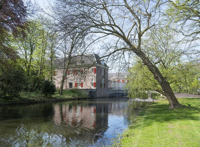 Manor slot zeist in the netherlands near utrecht. On sunny spring day with fresh color and blue sky stock photography
