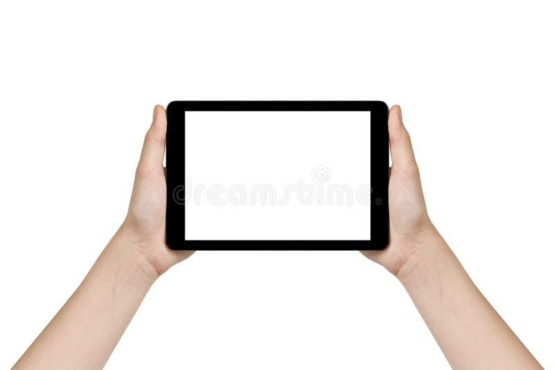Manos adolescentes femeninas que muestran la tableta genérica foto de archivo libre de regalías