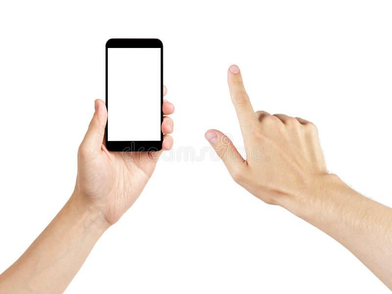Manos adultas del hombre usando el teléfono móvil genérico con la pantalla blanca fotografía de archivo